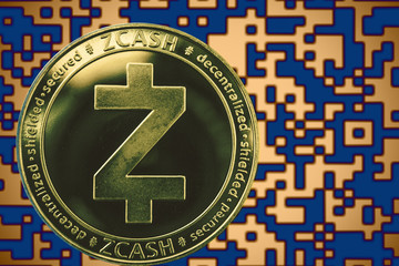 Token zec zcash coin cryptocurrency on the background of gold crypto code