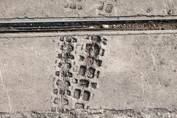 Wheel profile Tracks of a bicycle in fresh concrete