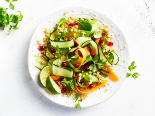 Cucumber, carrot , sugar pea and quinoa salad with pomegranate seeds. Vegan food