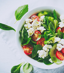 Cherry tomato, corn lettuce and cucumber salad with feta. Close up.