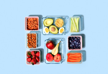 Healthy food concept, lunch boxes filled with fresh snacks