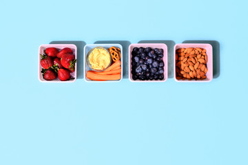 Healthy food concept, lunch boxes filled with snacks