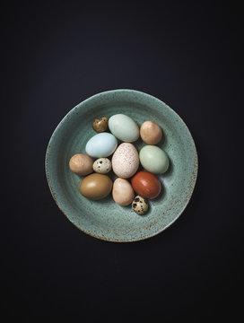 Multicolored Farm Fresh eggs in Ceramic Bowl
