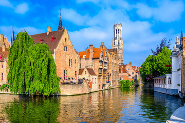 Wall Murals Bridges Classic view of the historic city center of Bruges (Brugge), West Flanders province, Belgium. Cityscape of Bruges with canal.