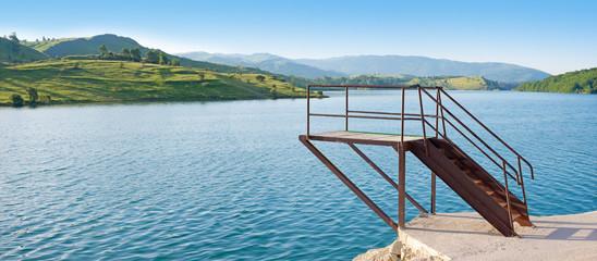 Swimmer diving board on Lake Klinje in Bosnia.