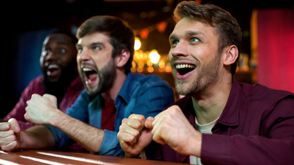 Nervous box fans watching favorite sport on big screen in bar, tournament Papier Peint
