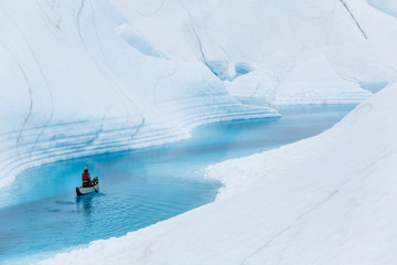 Wall Mural - Paddling a deep blue river on top of the Matanuska Glacier in the Alaskan wilderness