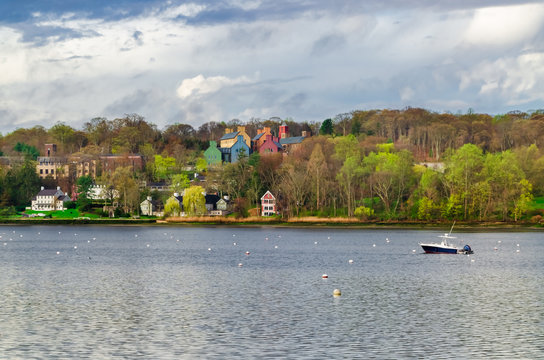 Typical landscape scenery with houses and a boat in Lloyd Harbor in Long Island New York
