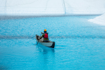 Wall Mural - Paddling clear blue lake on top of glacier ice in Alaska