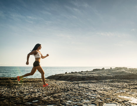 woman running on a sunny day at the beach