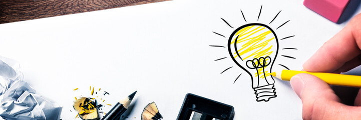 Hand Drawing Light Bulb On Paper - Bright Idea Concept Wall mural