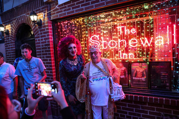 People take a picture outside the Stonewall Inn during the 50th Anniversary of the Stonewall Uprising in Manhattan in New York City