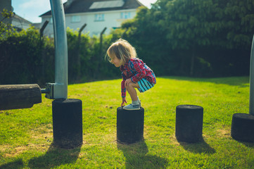 Little toddler balancing at the playground