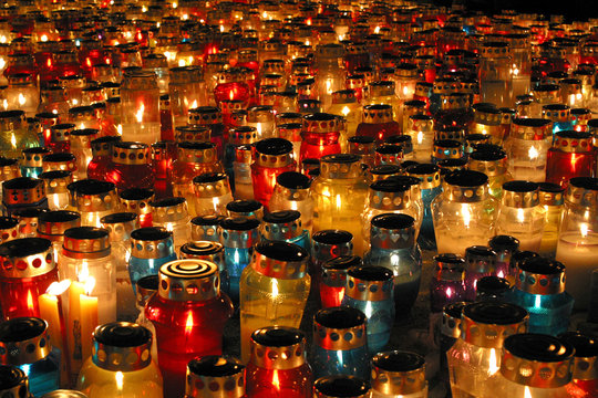 Memorial candles shining at the cemetery on the All Saints Day