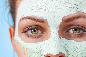 Girl with mud mask on face Fototapete