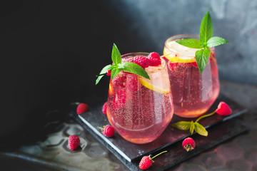 Sparkling pink raspberry lemonade on grey background