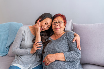 Senior Asian mother hugging her daughter. Love of mother and daughter. Aged woman and her adult daughter at home. Mothers day. Happy mother and daughter portrait