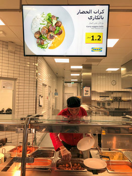 A chef prepares a meatballs dish for a customer at IKEA's food court, in Manama
