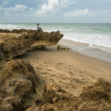Lone angler on Florida beach