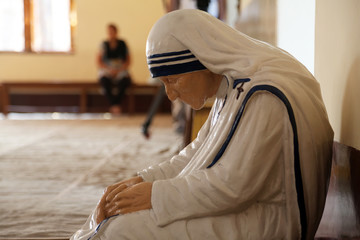 Statue of Mother Teresa in the chapel of the Mother House, Kolkata, India. The statue was made in the pose in which the Mother prayed.