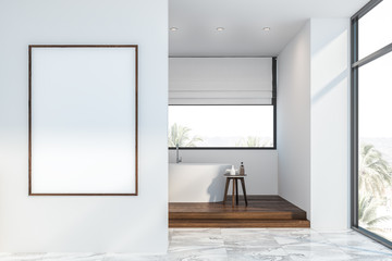 White loft bathroom with tub and poster