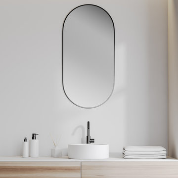 Bathroom sink in white room