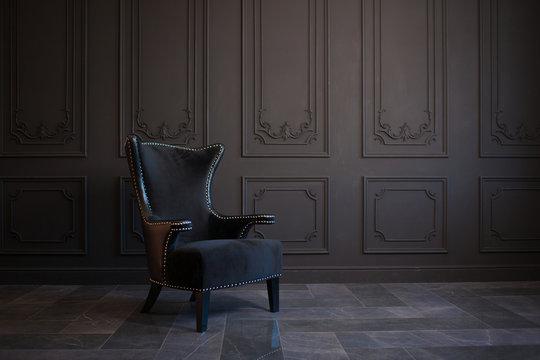 Stylish black chair against a dark gray wall