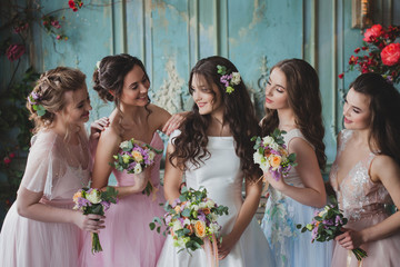 Beautiful young woman bride with friends. A wedding celebration