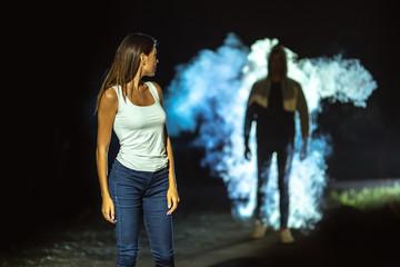 The man following the woman on the dark street