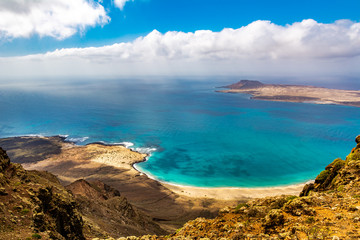 Amazing view of beautiful volcanic island Graciosa - panoramic view near Mirador del rio, Lanzarote. Location: north of Lanzarote, Canary Islands, Spain. Artistic picture. Beauty world.