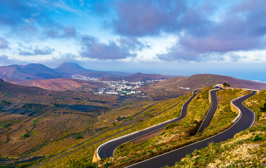 Amazing view of winding highway in the mountains Lanzarote. Location: Lanzarote, Canary Islands, Spain. Artistic picture. Beauty world.