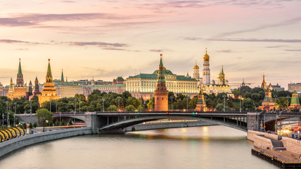 Fototapete - Moscow Kremlin at Moskva River, Russia. Panorama of old Moscow in summer evening. Scenic warm view of the ancient Moscow Kremlin at sunset. Beautiful cityscape of the famous Moscow center.
