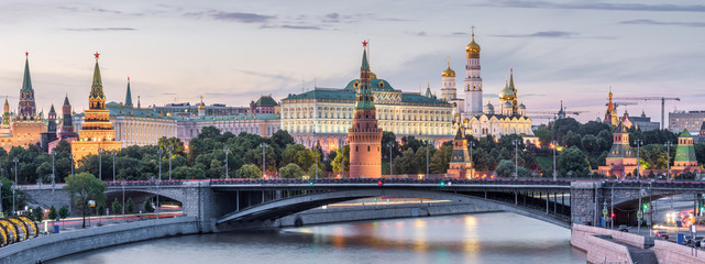 Moscow Kremlin at dusk, Russia. Panoramic view of the famous Moscow center in summer evening. Ancient Kremlin is a top landmark of Moscow. Beautiful cityscape of the old Moscow city in twilight.