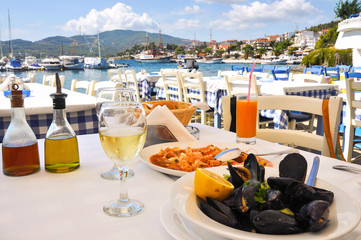 Seafood dinner in a Greek restaurant in Greece resort