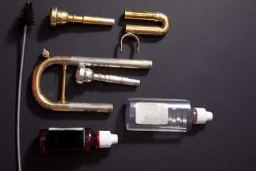 Trumpet parts with cleaning supplies
