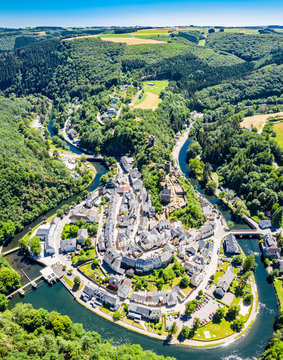 Aerial view of Esch-sur-Sure, medieval town in Luxembourg, dominated by castle, canton Wiltz in Diekirch. Forests of Upper-Sûre Nature Park, meander of winding river Sauer, near Upper Sauer Lake
