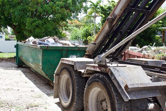 Debris from residential  construction site collected in roll off dumpster for efficient disposal
