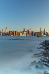 Midtown Manhattan  view from east river rocky beach with long exposure