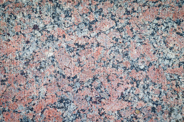 Surface of a granite stone, texture background