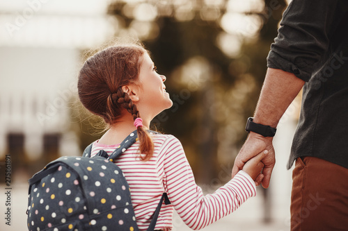 first day at school  father leads little child school girl