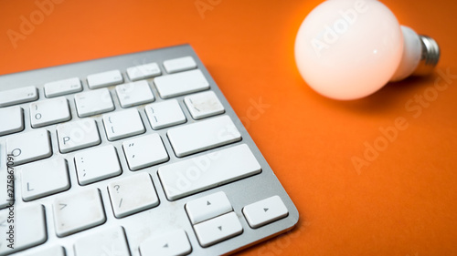 Wall mural keyboard and light on orange background