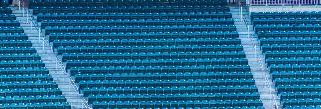 Rows of Many Green Seats in a stadium