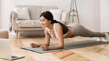 Online Training. Girl Exercising at Home, Doing Plank