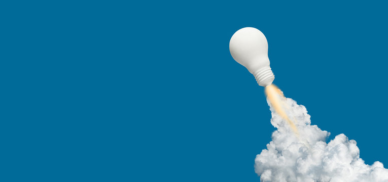 Ideas inspiration concepts with rocket lightbulb on blue background.Business start up or goal to success