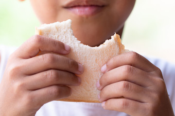 Closeup A Child eating bread