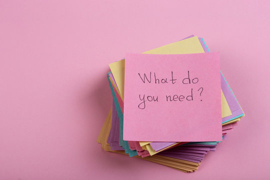 Help and advice concept - sticky note with text What do you need