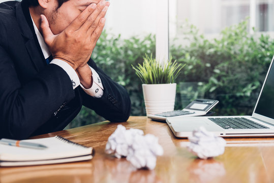 Asian young business man tired strain failure on he work