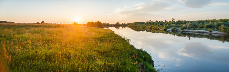 Beautiful evening natural landscape near the river during sunset. Ryazan region village Lasitsy Wall mural