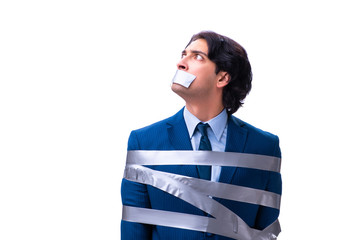 Tied employee with tape on mouth isolated on white