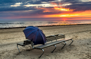 Colorful sunrise on sandy beach of the Baltic Sea,